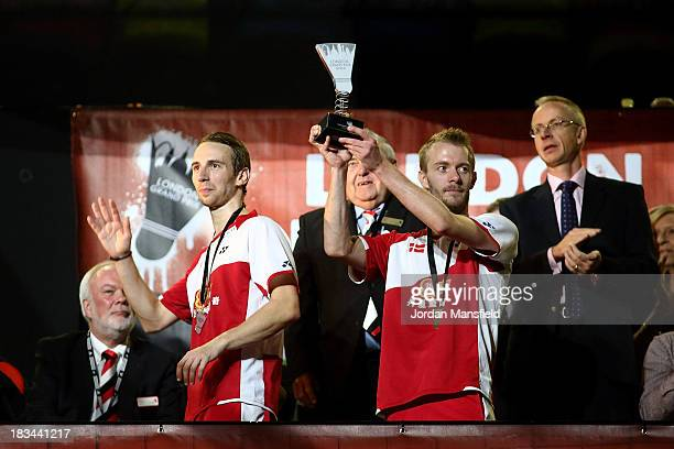 Mathian Boe and Carsten Mogensen of Denmark lift the trophy after winning the Men's Doubles Final against Berry Angriawan and Ricky Karanda Suwardi...