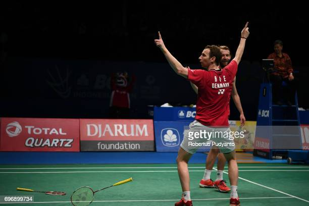 Mathias Boe and Carsten Mogensen of Denmark celebrate victory after beating Fajar Alfian and Muhammad Rian Ardianto of Indonesia during Mens Double...