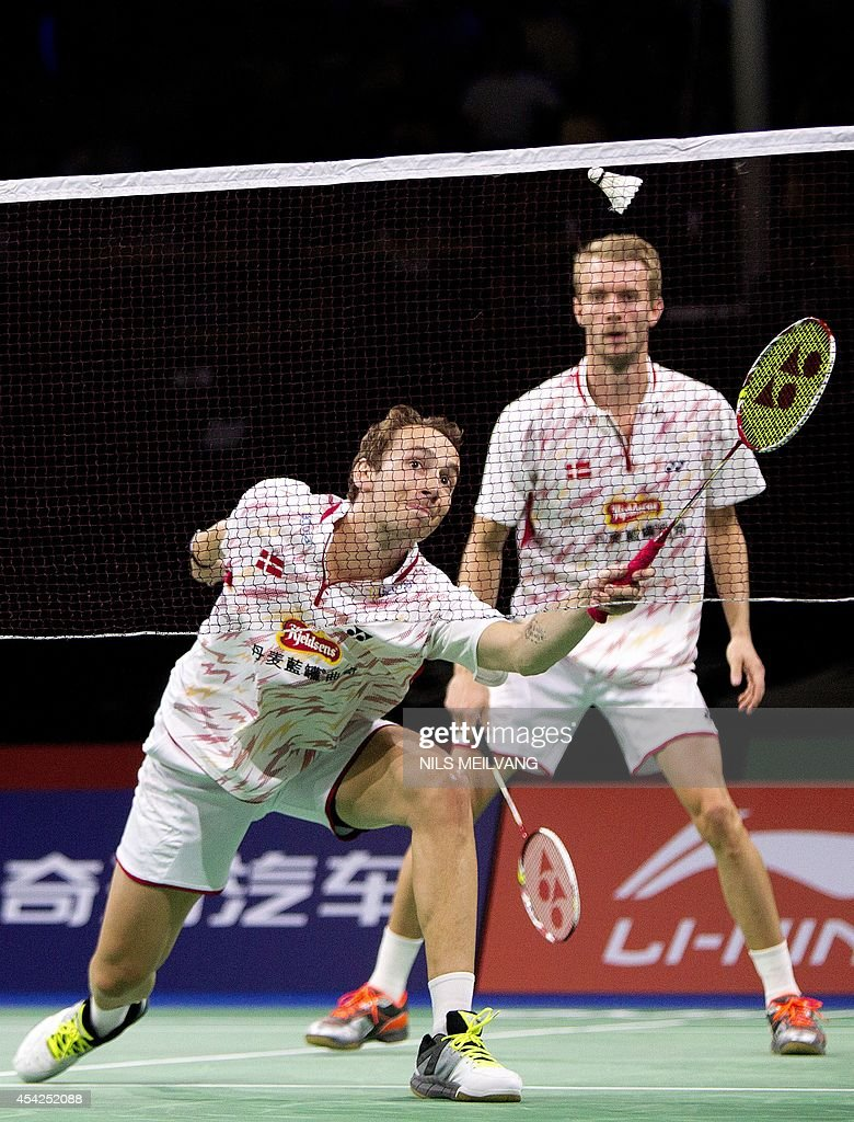 Mathias Boe and Carsten Mogensen of Denmark in action against Singapore's Danny Bawa Chrisnanta and Chayut Triyachart during Mens double match in Badminton World Championship in Copenhagen on August 27, 2014. AFP PHOTO / Scanpix DENMARK / Nils Meilvang / DENMARK OUT