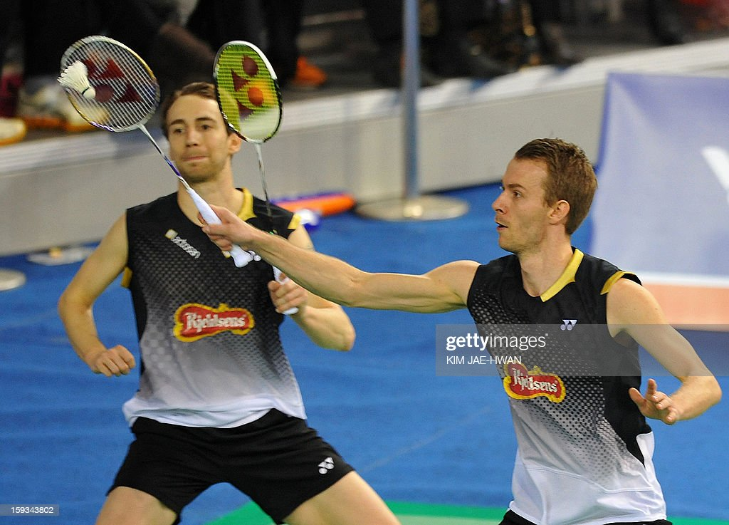 Mathias Boe (L) and Carsten Mogensen of Denmark play a shot during their men's doubles badminton match against Hong Wei and Shen Ye of China during the semi-finals of the Korea Open at Seoul on January 12, 2013. Mathias Boe and Carsten Mogensen won the match 19-21, 21-10, 21-18.