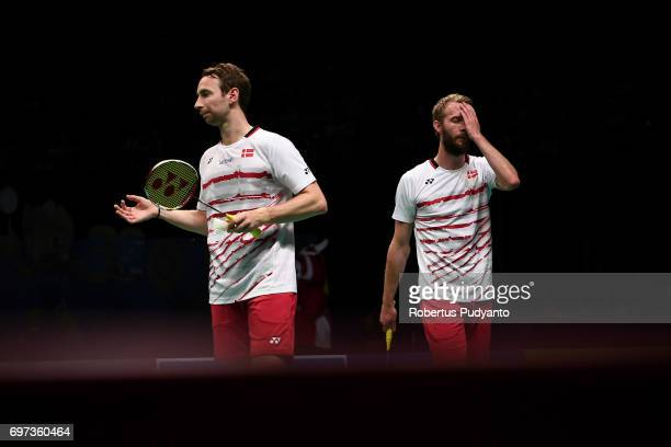 Mathias Boe and Carsten Mogensen of Denmark reacts after defeated by Li Junhui and Liu Yuchen of China during Men's Double Final match of the BCA...