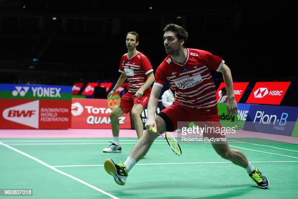 Mathias Boe and Mathias Christiansen of Denmark compete against Koceila Mammeri and Youcef Sabri Medel of Algeria during Preliminary Round on day two...