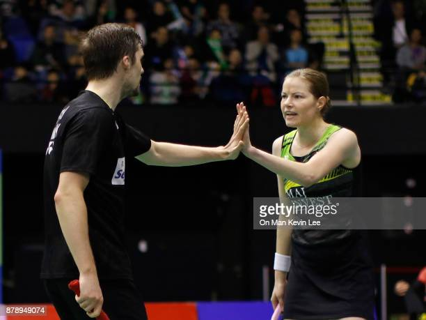 Mathias Christiansen of Denmark and Christinna Pedersen of Demark in action against Takuro Hoki and Sayaka Hirota of Japan during Mixed's Double of...