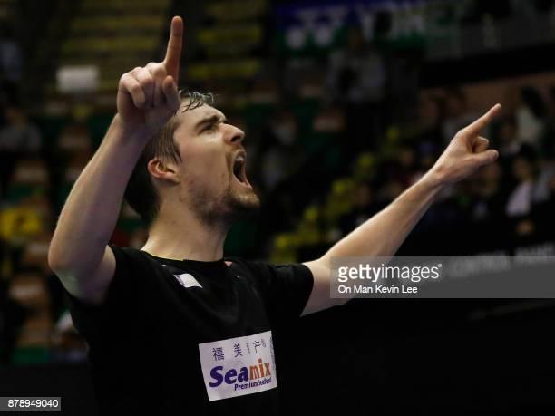 Mathias Christiansen of Denmark celebrates after defeating Takuro Hoki and Sayaka Hirota of Japan during Mixed's Double of SemiFinals match in...