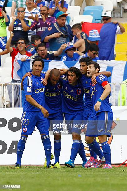 Mathias Corujo of U de Chile celebrates with teammates after scoring the opening goal during a match between Cobreloa and U de Chile as part of round...