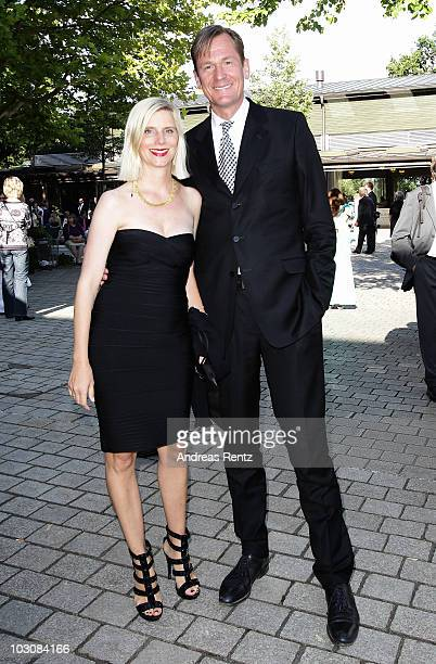 Mathias Doepfner and his wife Ulrike Doepfner attend at the 'Festspielhaus' during the opening performance of 'Lohengrin' at the Richard Wagner opera...