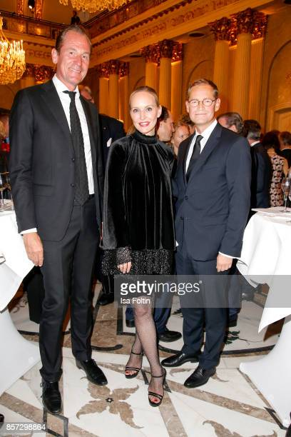 Mathias Doepfner Anne MeyerMinnemann and mayor of Berlin Michael Mueller during the ReOpening of the Staatsoper Unter den Linden on October 3 2017 in...