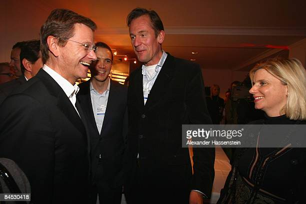 Mathias Doepfner CEO of Axel Springer AG and his wife Ulrike Doepfner talk to Guido Westerwelle chairman of the Free Democratic Party at the DLD...