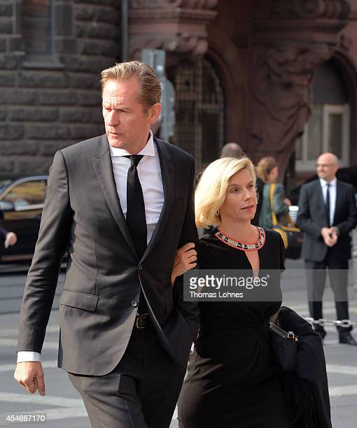 Mathias Doepfner chairman of German newspaper and magazine publisher Axel Springer and his wife Ulrike arrive at a service of commemoration for Frank...