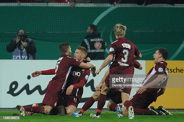 Mathias Fetsch of Offenbach celebrates with teammates after scoring a goal during the DFB Cup match between Kickers Offenbach and Fortuna Duesseldorf...