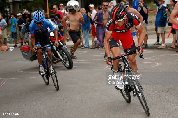 Mathias Frank of Switzerland and the BMC Racing Team accelerates past Lachlan Morton of Australia and Team GarminSharp on the last climb during stage...