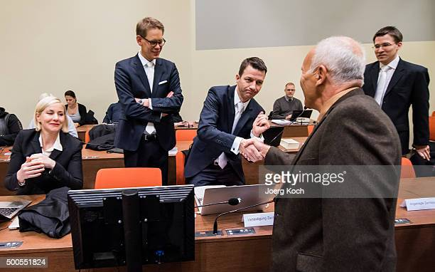 Mathias Grasel and Hermann Borchert new lawyers of Beate Zschaepe the main defendant in the NSU neoNazi murder trial greet her old lawyers Wolfgang...