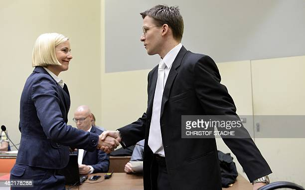 Mathias Grasel lawyer of a member of the alleged killer trio called the National Socialist Underground shakes hands with lawyer Anja Sturm in the...