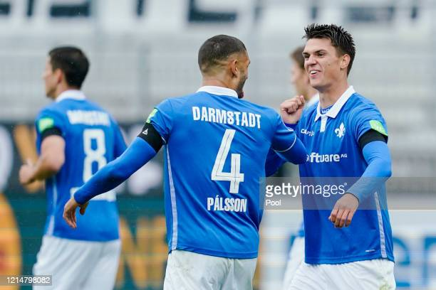 Mathias Honsak of SV Darmstadt 98 celebrates scoring his side's first goal with teammate Victor Palsson during the Second Bundesliga match between SV...