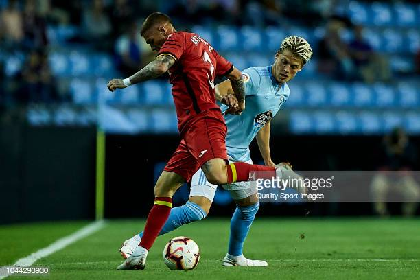 Mathias Jensen of Celta de Vigo competes for the ball with Vitorino Antunes of Getafe CF during the La Liga match between RC Celta de Vigo and Getafe...