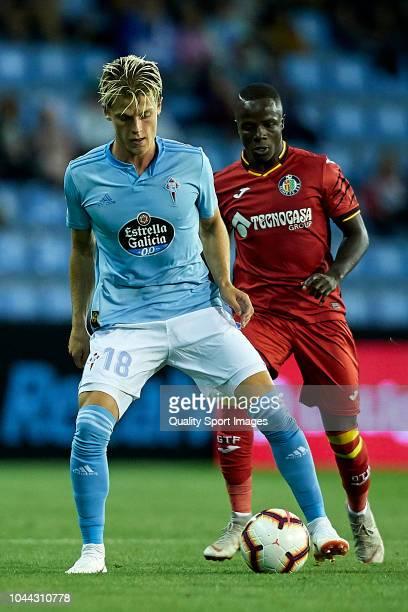 Mathias Jensen of Celta de Vigo is challenged by Amath Ndiaye of Getafe CF during the La Liga match between RC Celta de Vigo and Getafe CF at Estadio...