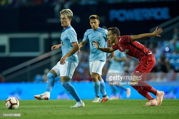 Mathias Jensen of Celta de Vigo is challenged by Nemanja Maksimovic of Getafe CF during the La Liga match between RC Celta de Vigo and Getafe CF at...