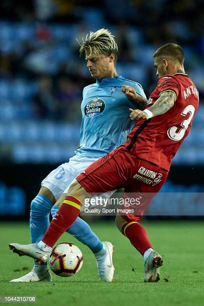Mathias Jensen of Celta de Vigo is challenged by Vitorino Antunes of Getafe CF during the La Liga match between RC Celta de Vigo and Getafe CF at...