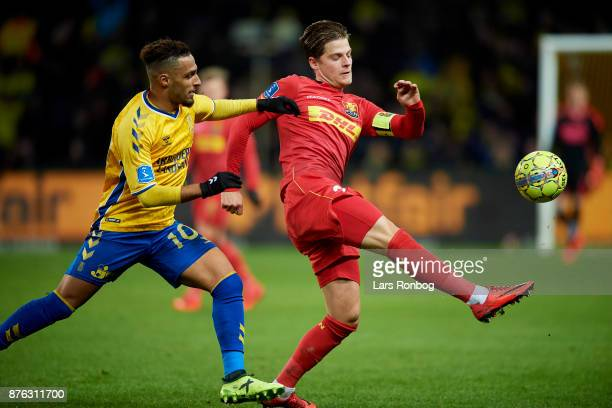 Mathias Jensen of FC Nordsjalland and Hany Mukhtar of Brondby IF compete for the ball during the Danish Alka Superliga match between Brondby IF and...