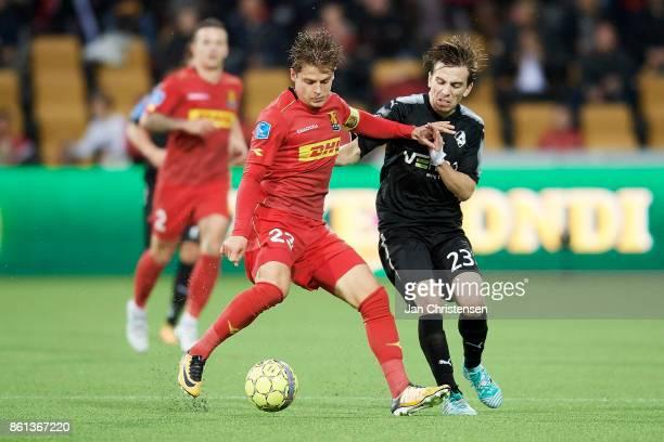 Mathias Jensen of FC Nordsjalland and Saba Lobzhanidze of Randers FC compete for the ball during the Danish Alka Superliga match between FC...