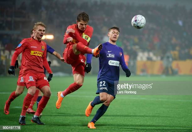 Mathias Jensen of FC Nordsjælland and Mikkel Duelund of FC Midtjylland compete for the ball during the Danish Alka Superliga match between FC...