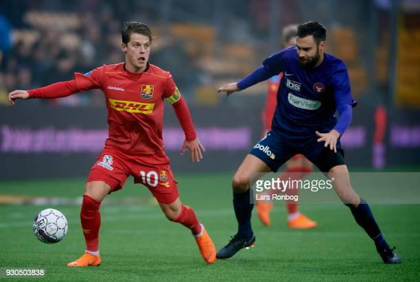 Mathias Jensen of FC Nordsjælland and Tim Sparv of FC Midtjylland compete for the ball during the Danish Alka Superliga match between FC Nordsjalland...
