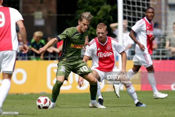 Mathias Jensen of FC Nordsj¾lland Dani de Wit of Ajax during the Club Friendly match between Ajax v FC Nordsjaelland at the Sportpark Putter Eng on...
