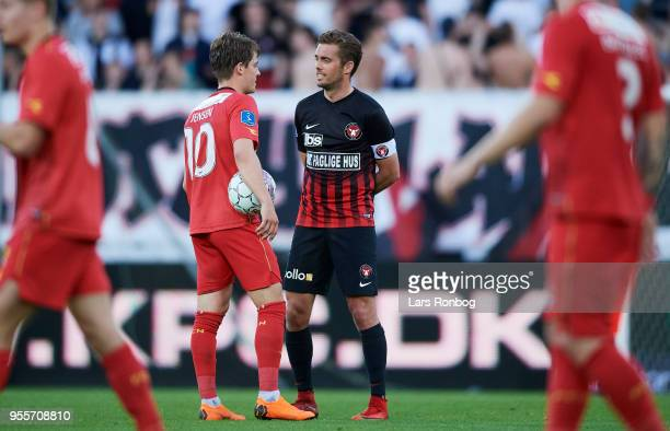Mathias Jensen of FC Nordsjælland speaks to Jakob Poulsen of FC Midtjylland during the Danish Alka Superliga match between FC Midtjylland and FC...