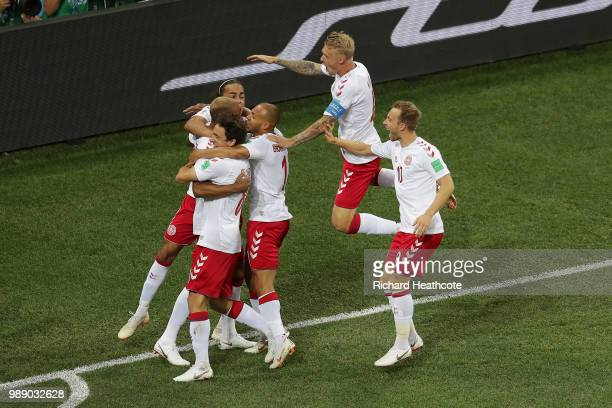 Mathias Jorgensen of Denmark celebrates with team mates after scoring his team's first goal during the 2018 FIFA World Cup Russia Round of 16 match...