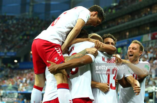 Mathias Jorgensen of Denmark celebrates with teammates after scoring his team's first goal during the 2018 FIFA World Cup Russia Round of 16 match...