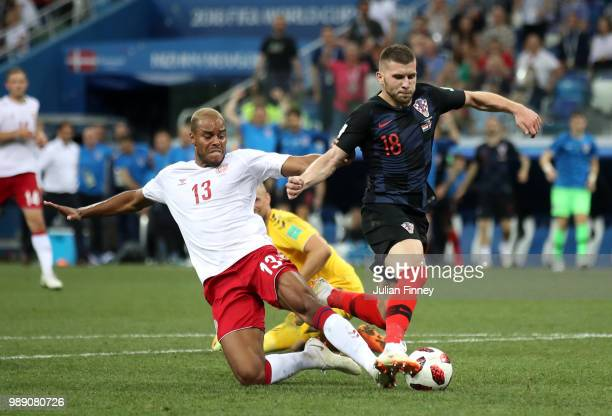 Mathias Jorgensen of Denmark fouls Ante Rebic of Croatia to give Croatia a penalty during the 2018 FIFA World Cup Russia Round of 16 match between...