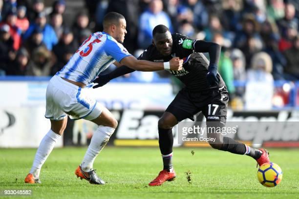 Mathias Jorgensen of Huddersfield Town and Christian Benteke of Crystal Palace battle for the ball during the Premier League match between...