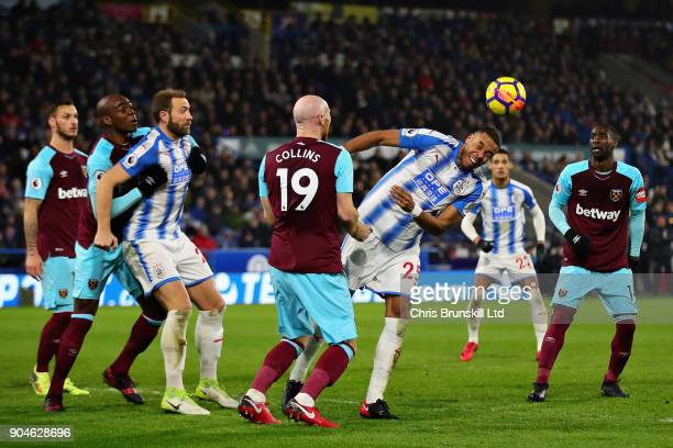 Mathias Jorgensen of Huddersfield Town heads the ball during the Premier League match between Huddersfield Town and West Ham United at John Smith's...