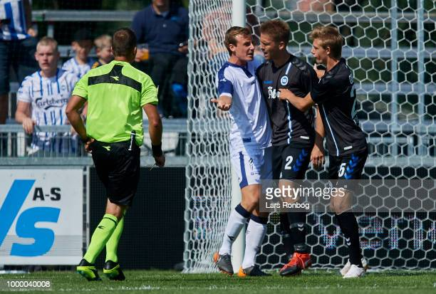 Mathias Jorgensen of OB Odense is keeping Kenneth Emil Petersen of OB Odense away from af discussion with Jeppe Svenningsen of Vendsyssel FF during...