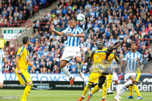 Mathias Jørgensen of Huddersfield Town heads the ball on during the Premier League match between Huddersfield Town and Crystal Palace at John Smith's...