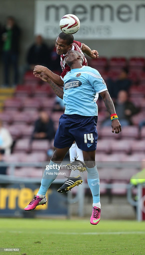 Mathias Kouo-Doumbe rises to head the ball from Chris Dickson of Dagenham & Redbridge during the Sky Bet League Two match between Northampton Town and Dagenham & Redbridge at Sixfields Stadium on October 19, 2013 in Northampton, England.