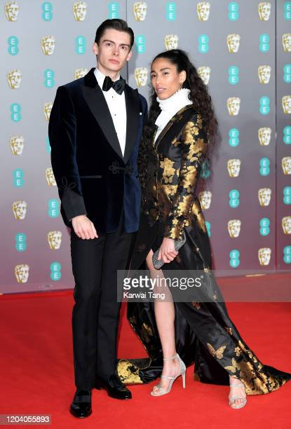 Mathias Le Fevre and Ciinderella Balthazar attend the EE British Academy Film Awards 2020 at Royal Albert Hall on February 02 2020 in London England
