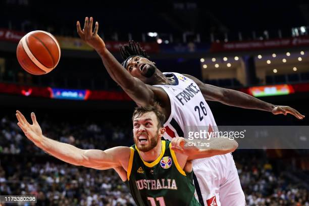 Mathias Lessort of France in action against Nicholas Kay of Australia during 2nd round Group L match between Australia and France of 2019 FIBA World...