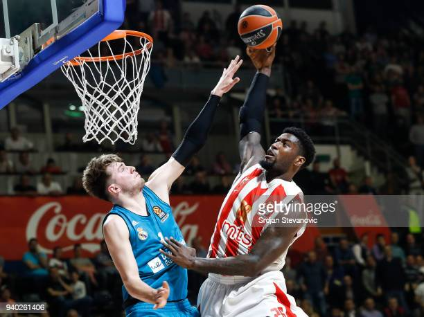 Mathias Lessort of Crvena Zvezda in action against Luka Doncic of Real Madrid during the 2017/2018 Turkish Airlines EuroLeague Regular Season game...