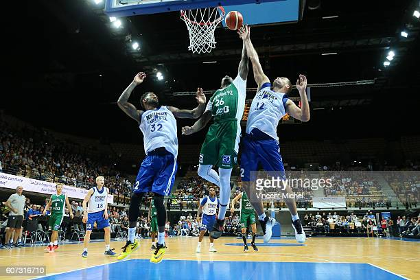 Mathias Lessort of Nanterre and Perry jones III and Sergey Monya of Khimki Moscow during the match for the 3rd and 4th place between Nanterre and...