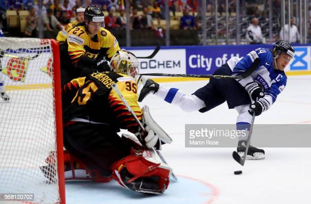 Mathias Niederberger goaltender of Germany tends net against Mikael Granlund of Finland during the 2018 IIHF Ice Hockey World Championship Group B...