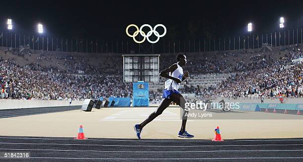 Mathias Ntawulikura of Rwanda rounds the final turn in the stadium before finishing the men's marathon on August 29 2004 during the Athens 2004...