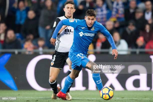 Mathias Olivera Miramontes of Getafe CF in action Gabriel Armando De Abreu of Valencia CF during the La Liga 201718 match between Getafe CF and...