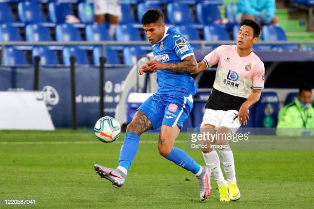 Mathias Olivera of FC Getafe and Wu Lei of Espanyol Barcelona battle for the ball during the Liga match between Getafe CF and RCD Espanyol at...
