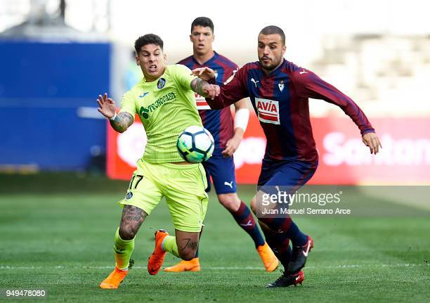 Mathias Olivera of Getafe CF duels for the ball with Pedro Leon of SD Eibar during the La Liga match between SD Eibar and Getafe CF at Ipurua...