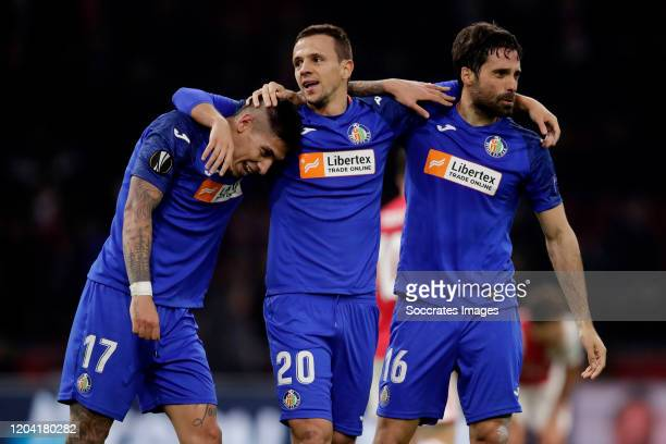 Mathias Olivera of Getafe Nemanja Maksimovic of Getafe Xabier Etxeitia of Getafe celebrates the victory during the UEFA Europa League match between...