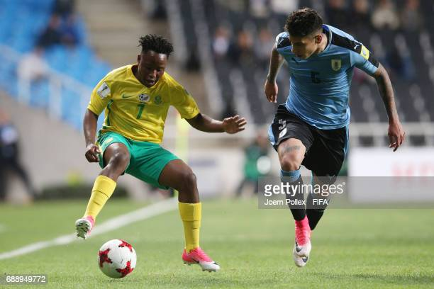 Mathias Olivera of Uruguay and Matlala Makgalwa of South Africa during the FIFA U20 World Cup Korea Republic 2017 group D match between Uruguay and...