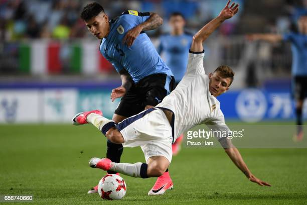 Mathias Olivera of Uruguay and Nicolo Barella of Italy compete for the ball during the FIFA U20 World Cup Korea Republic 2017 group D match between...