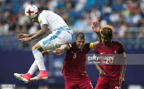 Mathias Olivera of Uruguay is challenged by Ruben Dias of Portugal and Gedson of Portugal during the FIFA U20 World Cup Korea Republic 2017 Quarter...