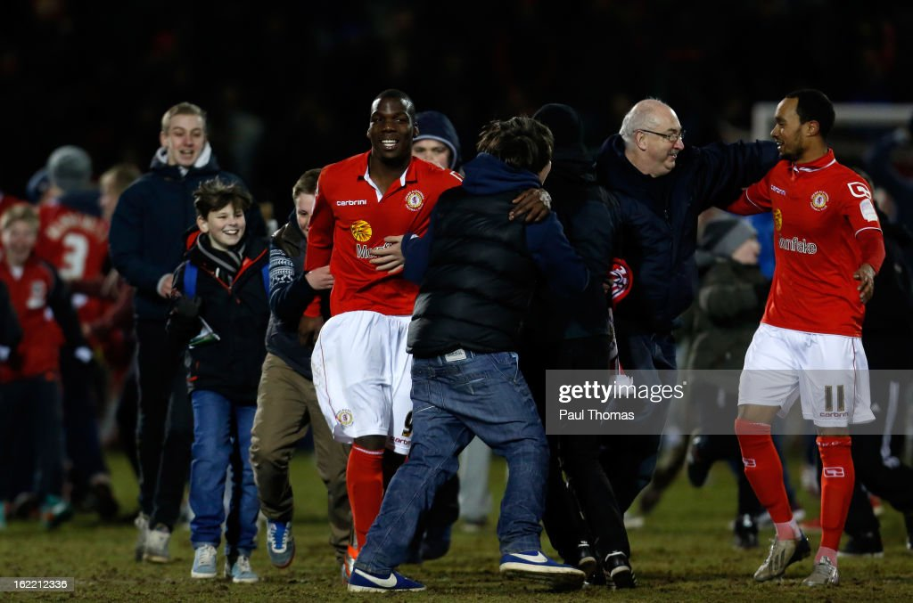 Mathias Pogba (L) and Byron Moore of Crewe are congratulated by fans at full time of the Johnstone's Paint Trophy Northern Section Final Second Leg match between Crewe Alexandra and Coventry City at the Alexandra Stadium on February 20, 2013 in Crewe, England.